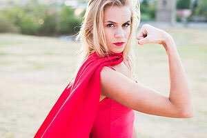 Young woman posing as superhero or wonderwoman